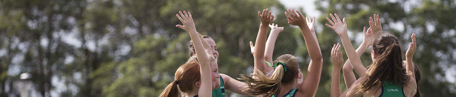 Netball girls hands in the air