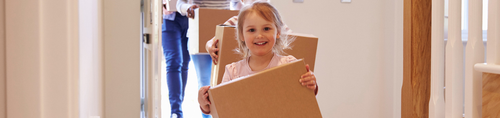 Young girl moving boxes