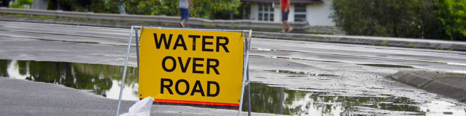 Water over road sign