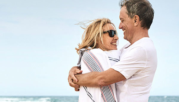 /content/dam/suncorp/corporate/images/learn-about/thumbnails/retirees-hugging-at-beach-600x342.jpg